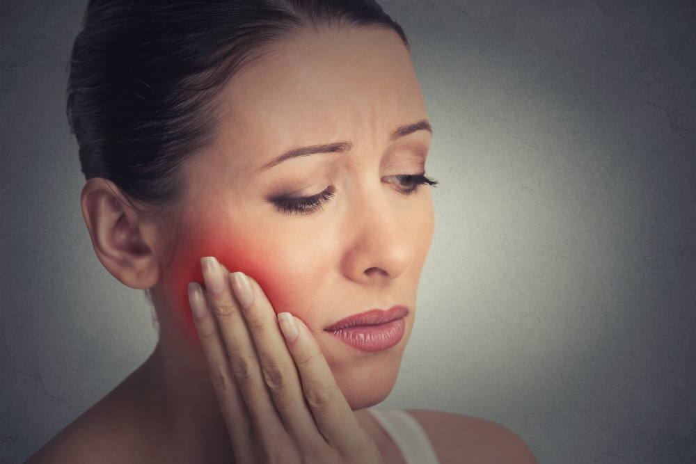 What is a periapical abscess in a tooth? Is it serious?